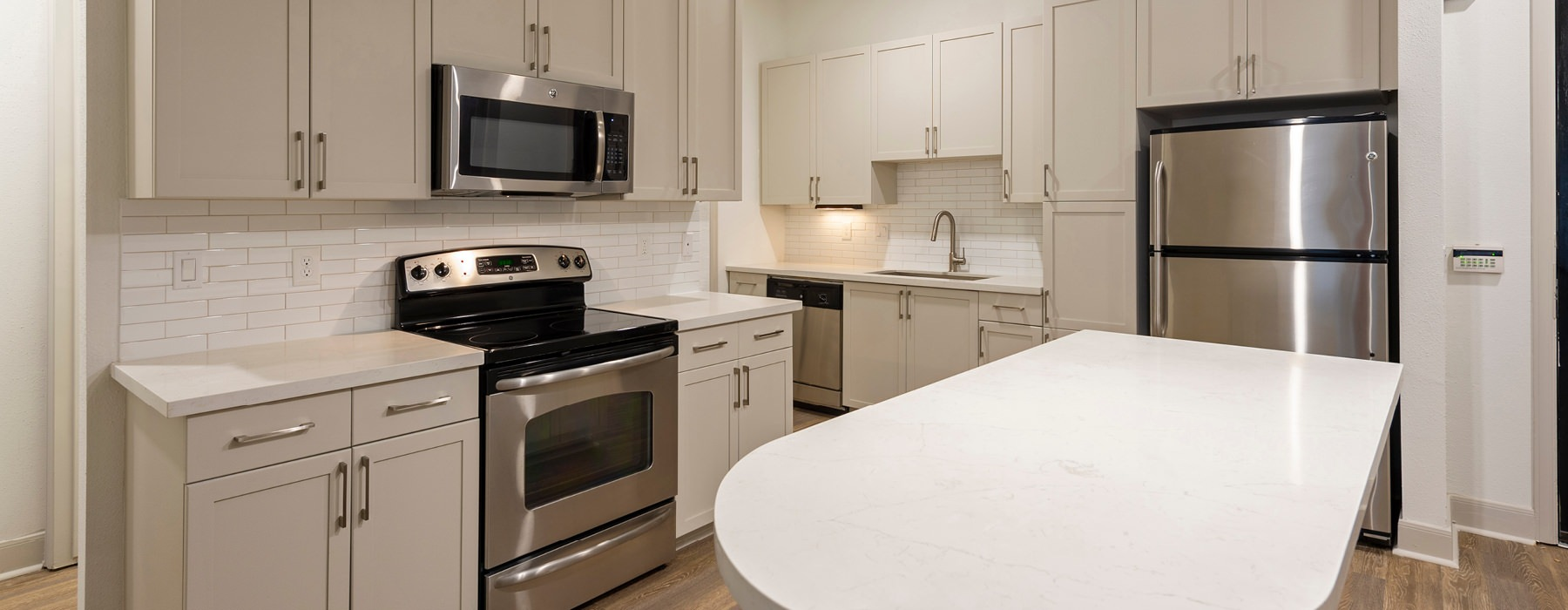 well lit open kitchen with island countertop